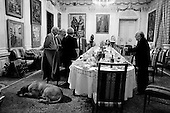 Moscow, Russia  .1998.Georgian sculptor, painter, architect Zurab Tseriteli speaks with his visiting Georgian friends after dinner in the dining room of his massive home/studio in central Moscow.  The walls are covered with his and only his, paintings..