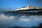 Great Britain, England, East Sussex, Brighton: Stormy sea beneath Brighton Pier