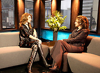 April 06, 2002, Montreal, Quebec, Canada;  HAND OUT PHOTO - <br /> <br /> Singer Celine Dion (L)) talk  with host Sonia Benezra (R) about her new ballad-heavy album, A New Day Has Come after her two-year break,  during  aTV interview to be broadcast April 6th, 2002 on Musimax