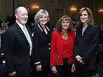 """SOUTHBURY, CT - 1 April 2004 - 040104TH04 - Steve Moran of Watertown, Chairman of the Board for United Way of Greater Waterbury, Kathie Hanratty of Watertown, Co-Chair of the United Way Campaign 2003-04,  Karen Pollard of Middlebury, Co-Chair of the United Way Campaign 2003-04, and Kristen Perrotti of Middlebury, President of the United Way of Greater Waterbury, pose at the United Way of Greater Waterbury """"Digging Deeper"""" Campaign 2003-04 Awards Dinner held at the Southbury Hilton Hotel Thursday night.  TODD HOUGAS PHOTO"""
