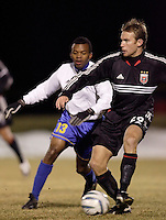 DC United's Bryan Namoff passes the ball while being trailed by Harbour View FC's Nicholas McCreath.  D.C. United defeated Harbour View F. C. 2 to 1 in quarterfinals action of The CONCACAF Champions Cup at Maryland SoccerPlex, Boyds, MD, on March 9, 2005.