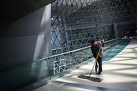 CHINA. Shanghai. A cleaner in the Shanghai Science and Technology Museum (?????; pinyin: Shàngh?i ke¯jì gu?n) is a large museum in Pudong, Shanghai, close to Century Park, the largest park of the city. The construction of the museum cost 1,75 billion RMB, and the floor area is 98 000m2 .2008..