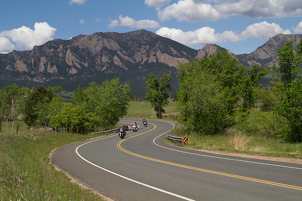 Motorcyclists on rural, mountain road in Boulder, Colorado .  John leads private photo tours in Boulder and throughout Colorado. Year-round.