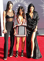 LOS ANGELES, CA, USA - AUGUST 24: Kendall Jenner, Kim Kardashian, Kylie Jenner at the 2014 MTV Video Music Awards held at The Forum on August 24, 2014 in the Los Angeles, California, United States. (Photo by Xavier Collin/Celebrity Monitor)
