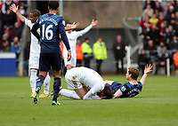 Pictured L-R: Michu of Swansea and Jan Vertonghen of Tottenham on the ground after a header. Saturday 30 March 2013<br /> Re: Barclay's Premier League, Swansea City FC v Tottenham Hotspur at the Liberty Stadium, south Wales.