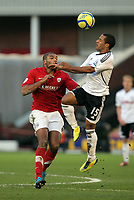 Pictured: Wayne Routledge of Swansea (R) heads the ball over Miles Addison of Barnsley (L). Saturday 07 January 2012<br /> Re: FA Cup football Barnsley FC v Swansea City FC at the Oakwell Stadium, south Yorkshire.