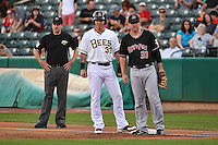 Josh Hamilton (33) of the Salt Lake Bees  and Jamie Romak (31) of the Albuquerque Isotopes at Smith's Ballpark on May 22, 2014 in Salt Lake City, Utah.  Base umpire Brian Hertzog.  The 2010 American League MVP from the Los Angeles Angels of Anaheim joined the Bees for a rehab stint. (Stephen Smith/Four Seam Images)