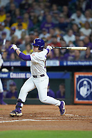 Zack Mathis (17) of the LSU Tigers follows through on his swing against the Texas Longhorns in game three of the 2020 Shriners Hospitals for Children College Classic at Minute Maid Park on February 28, 2020 in Houston, Texas. The Tigers defeated the Longhorns 4-3. (Brian Westerholt/Four Seam Images)