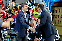 Tuesday, 7 May 2013<br /> <br /> Pictured: Michael Laudrup, Manager of Swansea City  shakes hands with Roberto Martinez, Manager of Wigan Athletic<br /> <br /> Re: Barclays Premier League Wigan Athletic v Swansea City FC  at the DW Stadium, Wigan