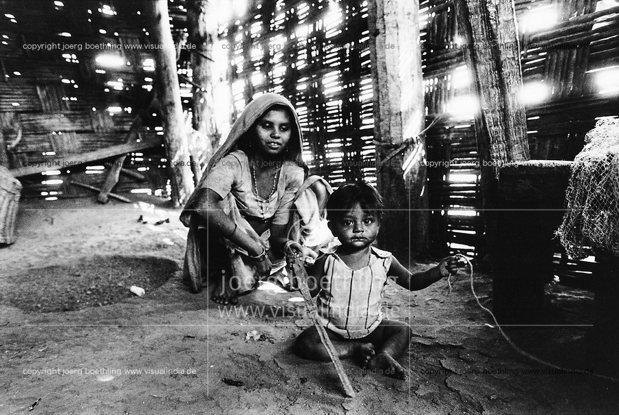India, Narmada River, Narmada dams and protest movement of NBA Narmada Bachao Andolan, movement to save the Narmada river, and affected Adivasi in their villages, Adivasi woman in hut, village Nimghavan, February 1994