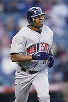 Jacque Jones of the Minnesota Twins runs the bases during a 2002 MLB season game against the Los Angeles Angels at Angel Stadium, in Anaheim, California. (Larry Goren/Four Seam Images)