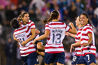 Tobin Heath (17) of the United States (USA) celebrates scoring a goal with teammates. The United States (USA) and Germany (GER) played to a 2-2 tie during an international friendly at Rentschler Field in East Hartford, CT, on October 23, 2012.