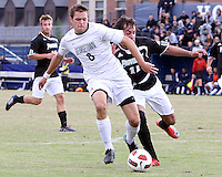 Tommy Muller #8 of Georgetown University gets past Giuseppe Guerriero #11 of Providence University during a Big East quarter-final  match at North Kehoe Field, Georgetown University on November 6 2010 in Washington D.C. Providence won 2-1.