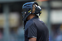 Home plate umpire Jose Navas works the International League game between the Scranton/Wilkes-Barre RailRiders and the Charlotte Knights at BB&T BallPark on August 14, 2019 in Charlotte, North Carolina. The Knights defeated the RailRiders 13-12 in ten innings. (Brian Westerholt/Four Seam Images)