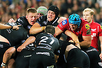 James King of the Ospreys (C) is supported by team mates as a Scarlets player attempts to grab the ball  during the Guinness PRO14 Round 6 match between Ospreys and Scarlets at The Liberty Stadium , Swansea, Wales, UK. Saturday 07 October 2017
