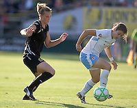 Leigh Ann Robinson (left) defends Karen Carney (right). FC Gold Pride and Chicago Red Stars tied 1-1 at Buck Shaw Stadium in Santa Clara, California on June 7, 2009.