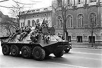 ROMANIA, Bucharest, 25.12.1989<br /> People rise against Ceausescu. The dictator has fled the city on dec. 22. There are still fights going on. Army personnel carrier BTR-80 speeding towards the national television building.<br /> © Andrei Pandele / EST&OST