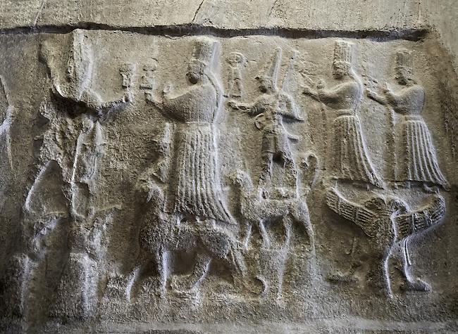 End relief panel of the 13th century BC Hittite religious rock carvings of Yazılıkaya Hittite rock sanctuary, chamber A, Hattusa, Bogazale, Turkey . Plastercast at the Vorderasiatisches Museum, Pergamon Museum, Berlin.