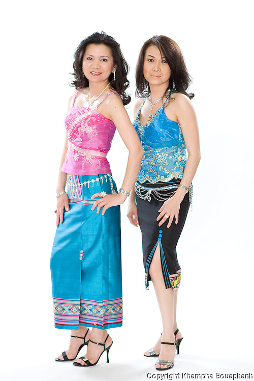 Phetsamone Cone, left, and Chanthaly Tan pose during the Lao New Year celebration at Wat Lao Thepnimith in Fort Worth on April 24, 2010.  (photo by Khampha Bouaphanh)