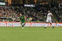 Portland, Oregon - Wednesday September 25, 2019: Jorge Moreira #2 plays the ball past Cristian Penilla #70 during a regular season game between Portland Timbers and New England Revolution at Providence Park on September 25, 2019 in Portland, Oregon.