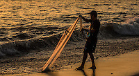 Fine Art Print Photograph, Sunset in Banderas Bay, Puerto Vallarta, Mexico. Net fisherman adjusts his fishing net in the rays of the setting sun.