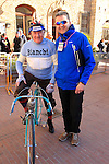 Andy Brady alongside old timer in traditional gear on vintage Bianchi before the start of the 2015 Strade Bianche Eroica Pro cycle race 200km over the white gravel roads from San Gimignano to Siena, Tuscany, Italy. 7th March 2015<br /> Photo: Eoin Clarke www.newsfile.ie