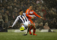 Pictured: Gylfi Sigurdsson of Swansea (R) challenged by Paul Scharner  (L) of West Bromwich. Saturday, 04 February 2012<br /> Re: Premier League football, West Bromwich Albion v Swansea City FC v at the Hawthorns Stadium, Birmingham, West Midlands.