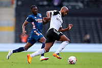 12th September 2020; Craven Cottage, London, England; English Premier League Football, Fulham versus Arsenal; Denis Odoi of Fulham goes past the challenge from Ainsley Maitland-Niles of Arsenal