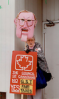 1990 FILE PHOTO - ARCHIVES -<br /> <br /> GST-Busters: Barbara Janes waves an effigy of Finance Minister Michael Wilson yesterday at a protest against the proposed goods and services tax outside his west-end constituency office.<br /> <br /> 1990<br /> <br /> PHOTO :  Erin Comb - Toronto Star Archives - AQP