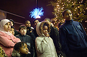 Local residents watch as Christmas lights organised by Church Street Neighbourhood Forum are turned on in Marylebone, London.