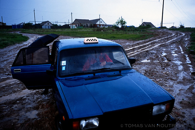 A Lada Taxi stops on a muddy road in Elista, Republic of Kalmykia, Russian Federation in May 12, 2010.