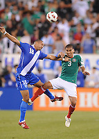 Guatemala Oscar Isaula (18) heads the ball against Mexico Carlos Salcido (3)    Mexico defeated Guatemala 2-1 in the quaterfinals for the 2011 CONCACAF Gold Cup , at the New Meadowlands Stadium, Saturday June 18, 2011.