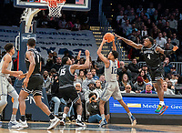WASHINGTON, DC - FEBRUARY 19: Maliek White #4 of Providence reaches in as Terrell Allen #12 of Georgetown is about to pass the ball during a game between Providence and Georgetown at Capital One Arena on February 19, 2020 in Washington, DC.