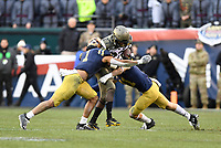PHILADELPHIA, PA - DEC 14, 2019: Army Black Knights running back Brandon Walters (27) is tackled by Navy Midshipmen linebacker Jacob Springer (1) and Navy Midshipmen safety Evan Fochtman (11) during game between Army and Navy at Lincoln Financial Field in Philadelphia, PA. The Midshipmen defeated Army 31-7. (Photo by Phil Peters/Media Images International)