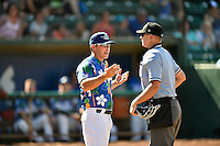 Ogden Raptors manager Shaun Larkin (5) discusses a play with home plate umpire Josh Sword as the Ogden Raptors played the Helena Brewers in Pioneer League action at Lindquist Field on July 16, 2016 in Ogden, Utah. Ogden defeated Helena 5-4.  (Stephen Smith/Four Seam Images)