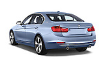 Car pictures of rear three quarter view of a 2014 BMW SERIES 3 Sport 4 Door Sedan 2WD Angular Rear
