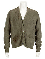 BNPS.co.uk (01202 558833)<br /> Pic: Julien's/BNPS<br /> <br /> This unwashed old cardy might smell like teen spirit...but its expected to sell for a whopping £200,000 at auction later this month.<br /> <br /> It's the cardigan Kurt Cobain wore during the lconic MTV Unplugged performance by Nirvana in November 1993.<br /> <br /> Also being sold is the custom made left handed Fender Mustang electric guitar Cobain took it on tour with him in 1993 and '94.<br /> <br /> Amazingly the £400,000 guitar was gifted to a fan who wrote to Courtney Love after the Nirvana frontman's tragic suicide in 1994.<br /> <br /> The two items are being auctioned off to mark the 25th anniversary of the rock star's untimely death.