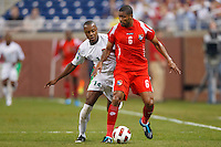 Panama midfielder Gabriel Gómez (6) shields the ball from Guadeloupe midfielder Gregory Gendrey (14) during the CONCACAF soccer match between Panama and Guadeloupe at Ford Field Detroit, Michigan.