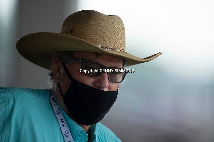 Trainer Larry Jones takes in the ninth race at Ellis Park in Henderson, Ky., Sunday afternoon, Aug. 9, 2020. The horse he trains, Istan Council, finished third.