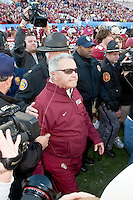 January 01, 2010:   Florida State head coach Bobby Bowden walks on the field to greet the West Virginia head coach during Konica Minolta Gator Bowl College football action between the West Virginia Mountaineers and the Florida State Seminoles played at the Jacksonville Municipal Stadium in Jacksonville, Florida on January 01, 2010.  Florida State defeated West Virginia 33-21.
