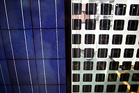 CHINA. Hebei.  Finished solar cells inside a factory producing solar panels in Baoding City near Beijing, the world's first 'carbon positive' town. The town's main industires focus on producing wind and solar technologies. 2009