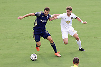CARY, NC - AUGUST 01: Steven Miller #31 shields Jonathan Dean #24 off of the ball during a game between Birmingham Legion FC and North Carolina FC at Sahlen's Stadium at WakeMed Soccer Park on August 01, 2020 in Cary, North Carolina.