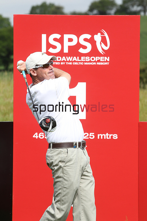 ISPS Handa Wales Open 2012.Former USPGA Champion Rich Beem driving at the 1st hole in the Pro-Am...30.05.12.©Steve Pope