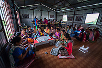Nepal, Kathmandu, Kokhana. The nonprofit Sabah, running a clothing making business to help women workers. Women sewing and knitting Sherpa Adventure gear, a Nepal brand exported to Europe. These women prefer to work as a community rather than alone doing home based work. Model released