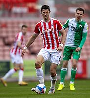 5th April 2021; Bet365 Stadium, Stoke, Staffordshire, England; English Football League Championship Football, Stoke City versus Millwall; Danny Batth of Stoke City looks to pass the ball
