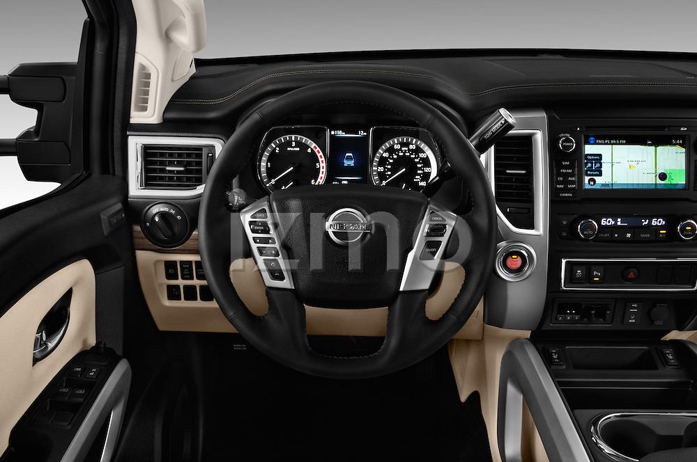 Car pictures of steering wheel view of a 2016 Nissan Titan SL 4 Door Pickup Steering Wheel