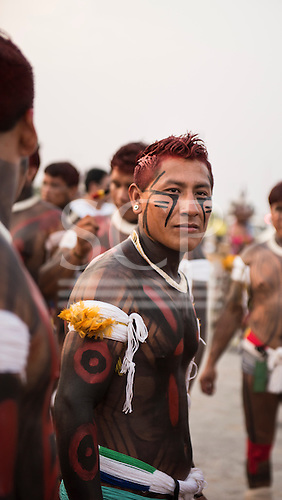 A Kuikuro warrior with traditional face and body paint looks proudly at the camera during a cultural presentation at the first ever International Indigenous Games, in the city of Palmas, Tocantins State, Brazil. The games will start with an opening ceremony on Friday the 23rd October. Photo © Sue Cunningham, pictures@scphotographic.com 21st October 2015