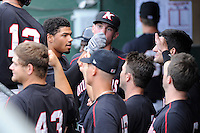 Center fielder Jacob May (20) of the Kannapolis Intimidators is congratulated after hitting a leadoff home run in a game against the Greenville Drive on Monday, August 5, 2013, at Fluor Field at the West End in Greenville, South Carolina. May was a third-round pick by the Chicago White Sox in the 2013 First-Year Player Draft. Kannapolis won, 3-0. (Tom Priddy/Four Seam Images)