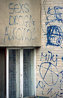 Kosovo. Pristina. Graffiti on a wall. Sex, drugs, alcohol, anarchism... © 2001 Didier Ruef