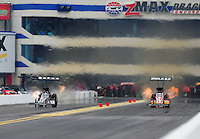 Sept. 17, 2011; Concord, NC, USA: NHRA top fuel dragster driver Larry Dixon (left) races alongside Spencer Massey during qualifying for the O'Reilly Auto Parts Nationals at zMax Dragway. Mandatory Credit: Mark J. Rebilas-